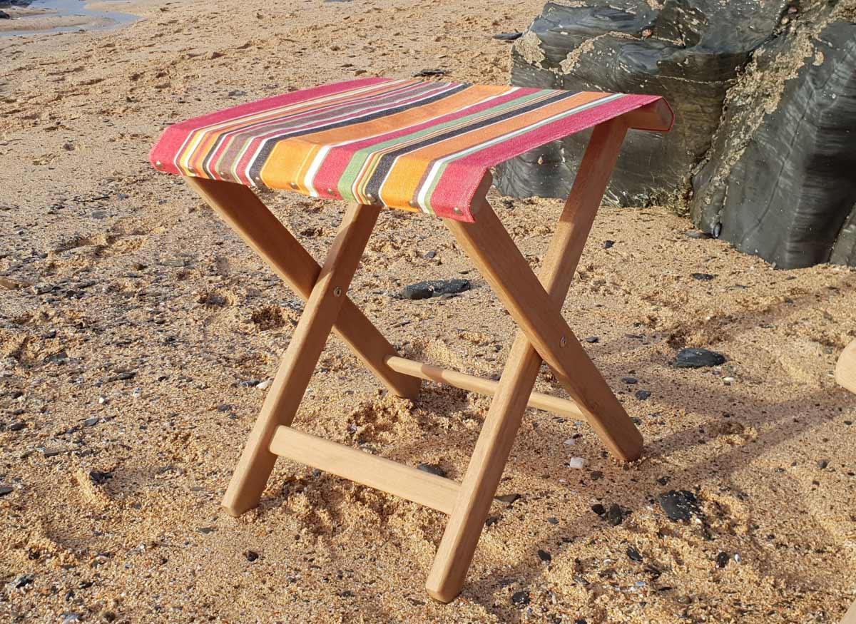 deckchair footstool on the beach handmade by cornwall joiner