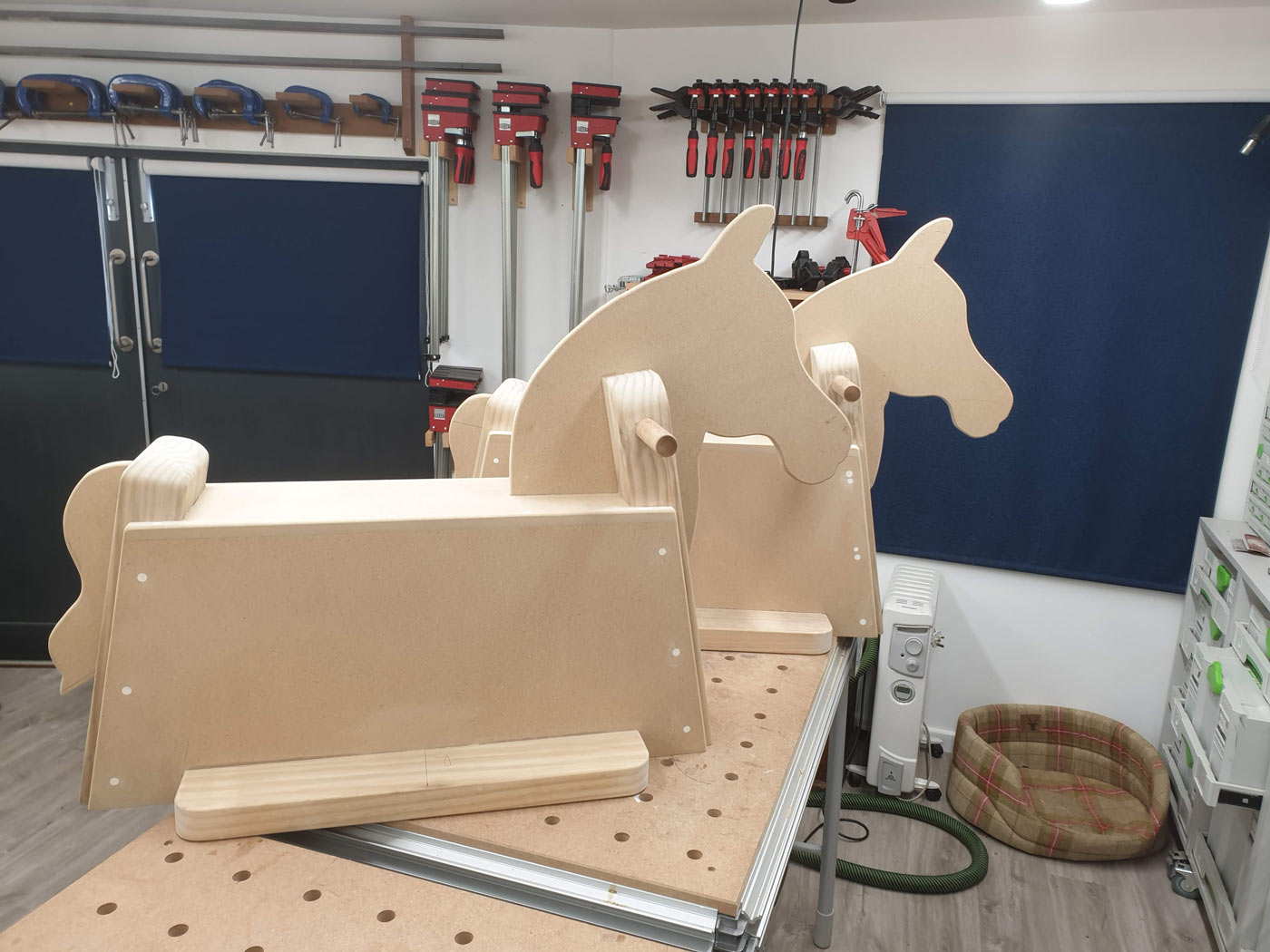 two new rocking horses made of mdf and pine for childrens park st merryn padstow cornwall